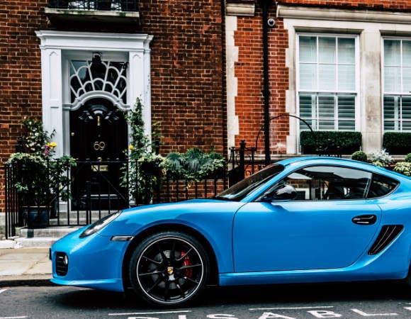 Blue Porsche parked on street